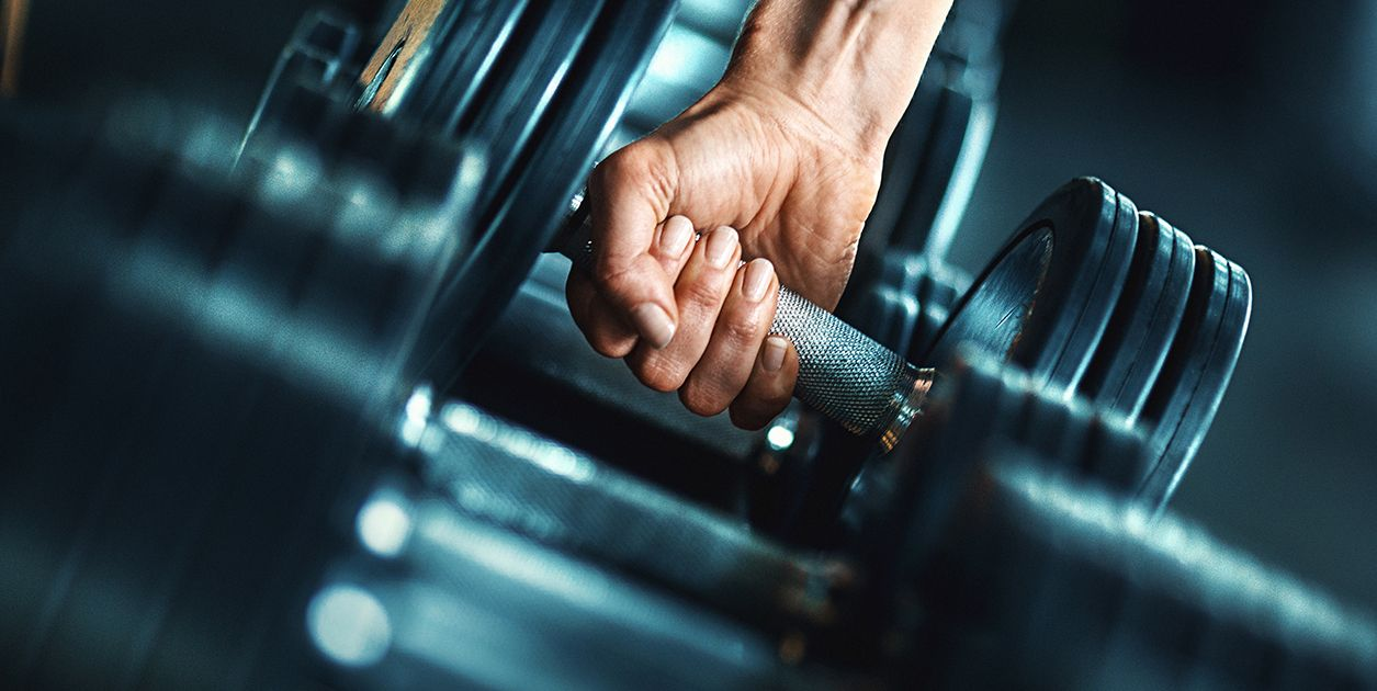 Close up of a hand holding a dumbbell