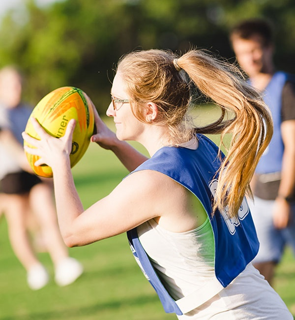 Close-up of a student playing touch rugby