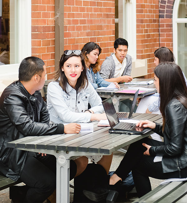 Students sitting at table.