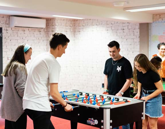 Students playing table soccer.