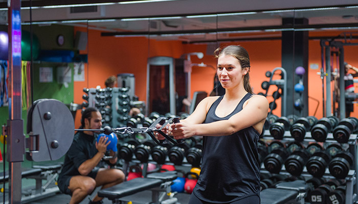 ACU student working out at the gym