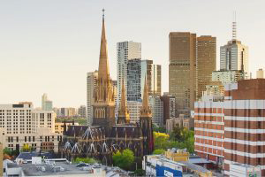 An aerial photo of the Melbourne cityscape. StPatrick's Cathedral is prominently featured.